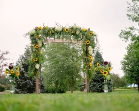 August 29.2015 arbor with sunflowers